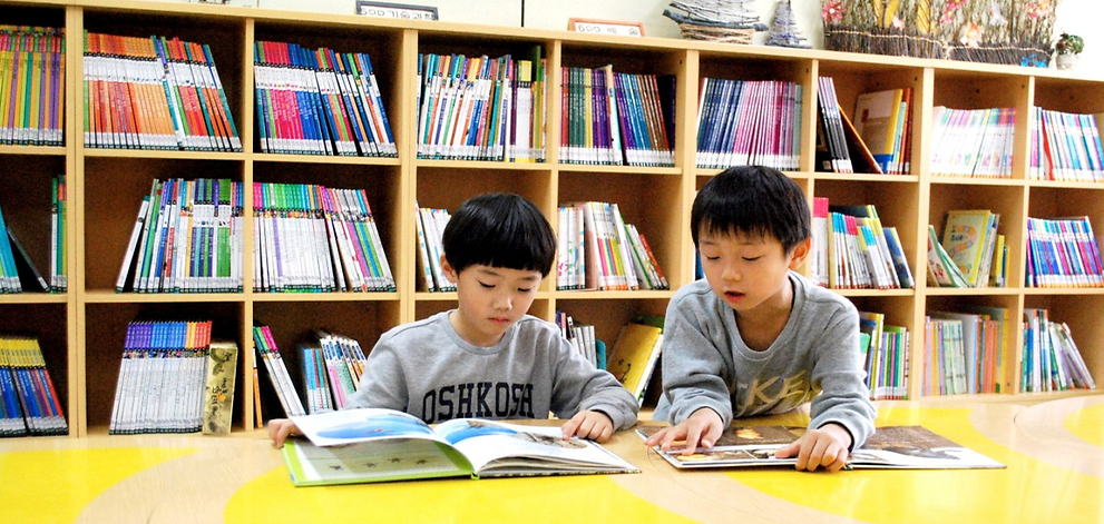 file-photo-of-kids-reading-books---2447860