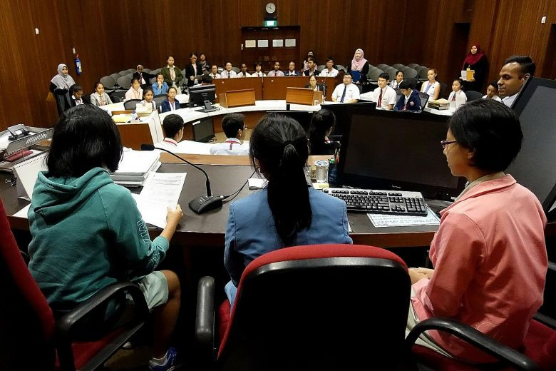 "Secondary school students role-playing in a mock trial as part of the ""A Day In Court"" seminar, organised by the State Courts of Singapore. The participants took up their roles with utmost gravity as they had to decide the offender's punishment, while considering four principles - retribution, deterrence, prevention and rehabilitation - used by judges in the Republic as a guide to the sentencing process.ST PHOTO: WONG KWAI CHOW"