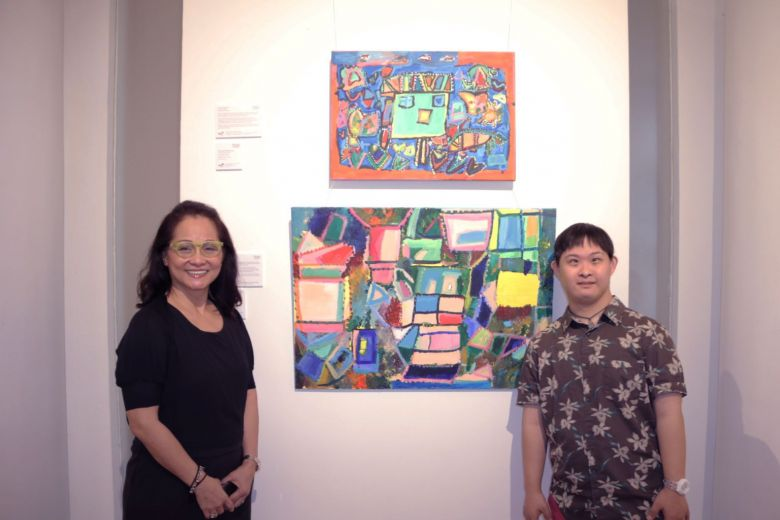 Mr Cavan Chang and his mother, Madam Cecilia Lai, with his pieces at the exhibition.PHOTO: HOSANNA CHANDRASEKRAN