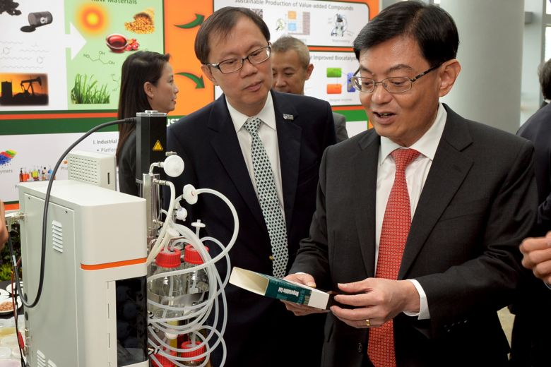 Finance Minister Heng Swee Keat (right) with Professor Ho Teck Hua, senior deputy president and provost of National University of Singapore, at the launch of WIL@NUS Corporate Laboratory.ST PHOTO: KHALID BABA